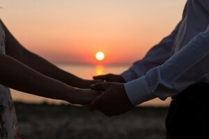 Quality time - A sunset with two people holding hands
