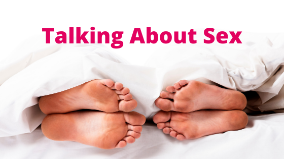 Talking about sex - two people's feet stick out from underneath the covers and they are facing each other.