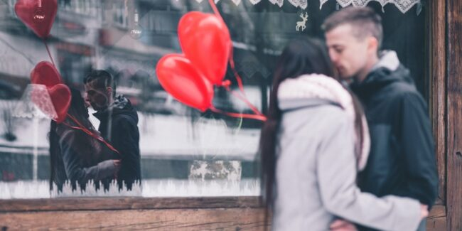 Mirroring in a romantic relationship - a couple's reflection showing in a window