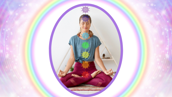 How to Open Your Chakras - A woman sitting in with the chakras super imposed over her body.