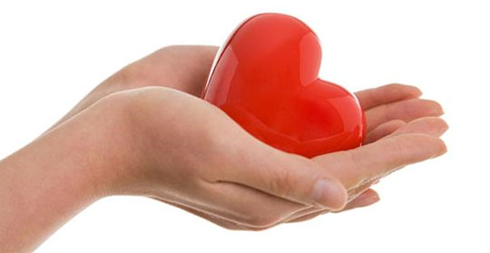 heart energy - picture of a hand holding a porcelain heart.
