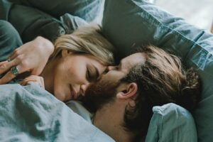 Sexual intimacy with your spouse again -Couple in bed being close