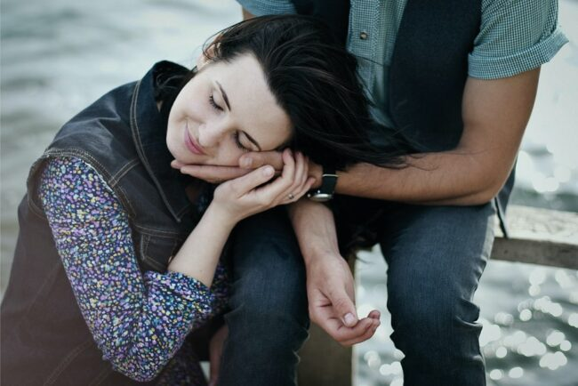 divine love meaning - a woman feeling the love from her partner
