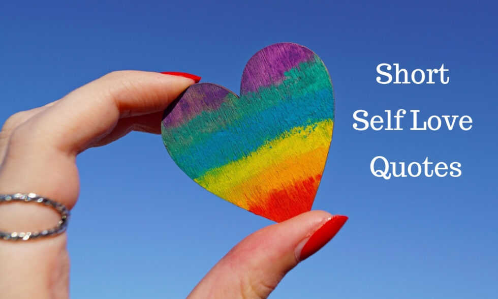 Short Self Love Quotes - Picture of a woman's fingers hold a rainbow colored heart