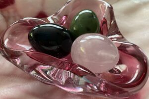 Yoni egg testimonials - picture of a rose quartz, jade and obsidian egg