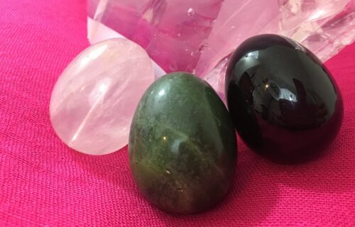 Jade, rose quartz and obsidian eggs displayed to promote benefits of yoni eggs