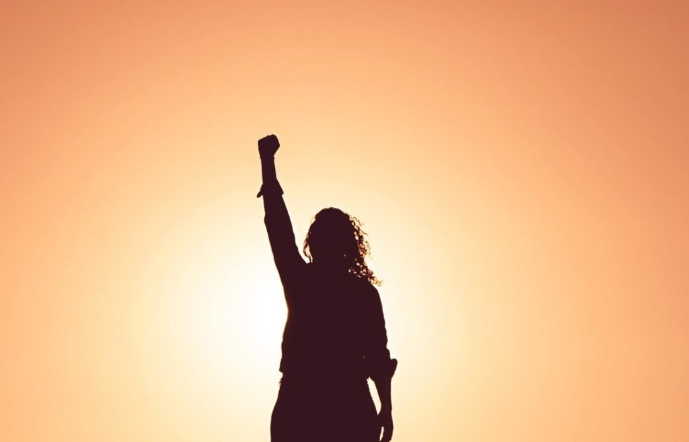 Life force energy - A woman raising her hand like the statue of libert.